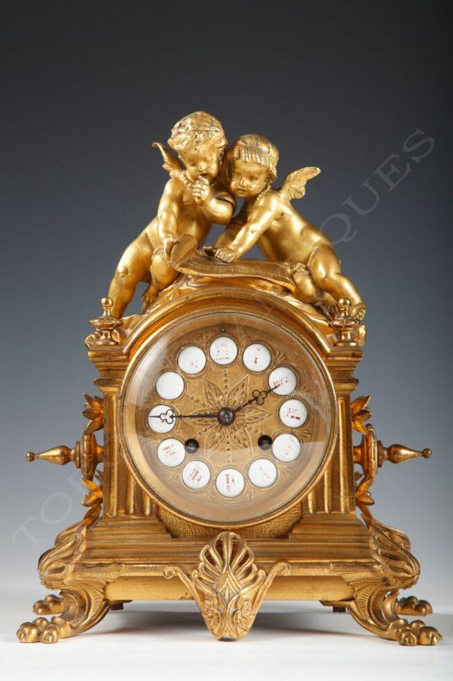 D'Aureville, Chameroy & Barbot<br/>Clock with cupids