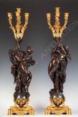 A pair of Candelabra with cupid and psyche
