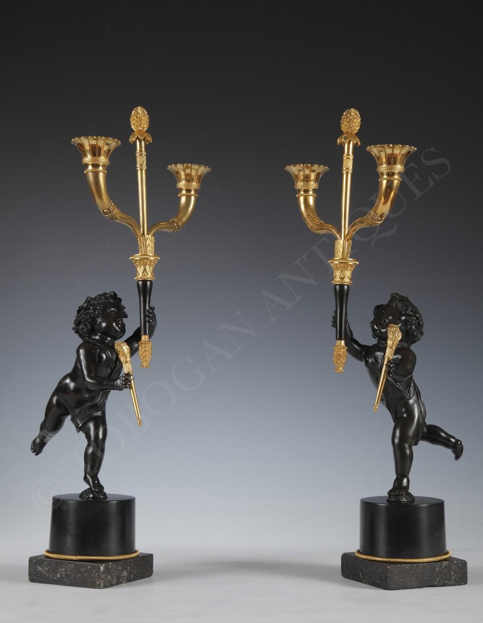 A lovely pair of cherub candelabra