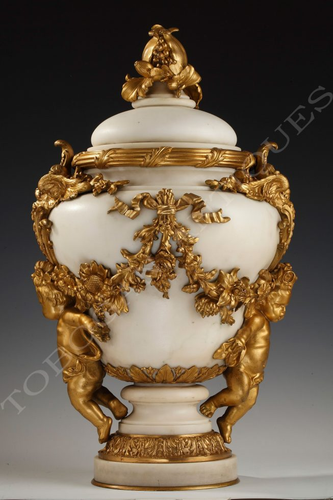 E. Cornu <br/> A marble covered urn