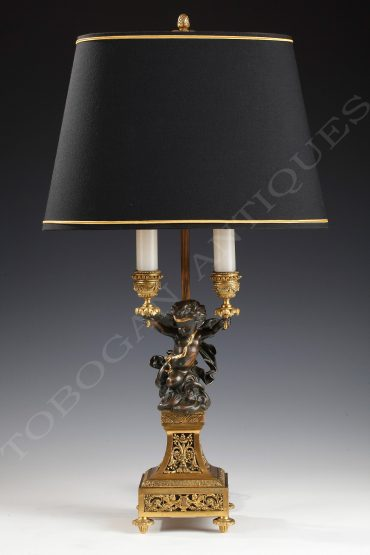 Gilt and patinated lamp with putto