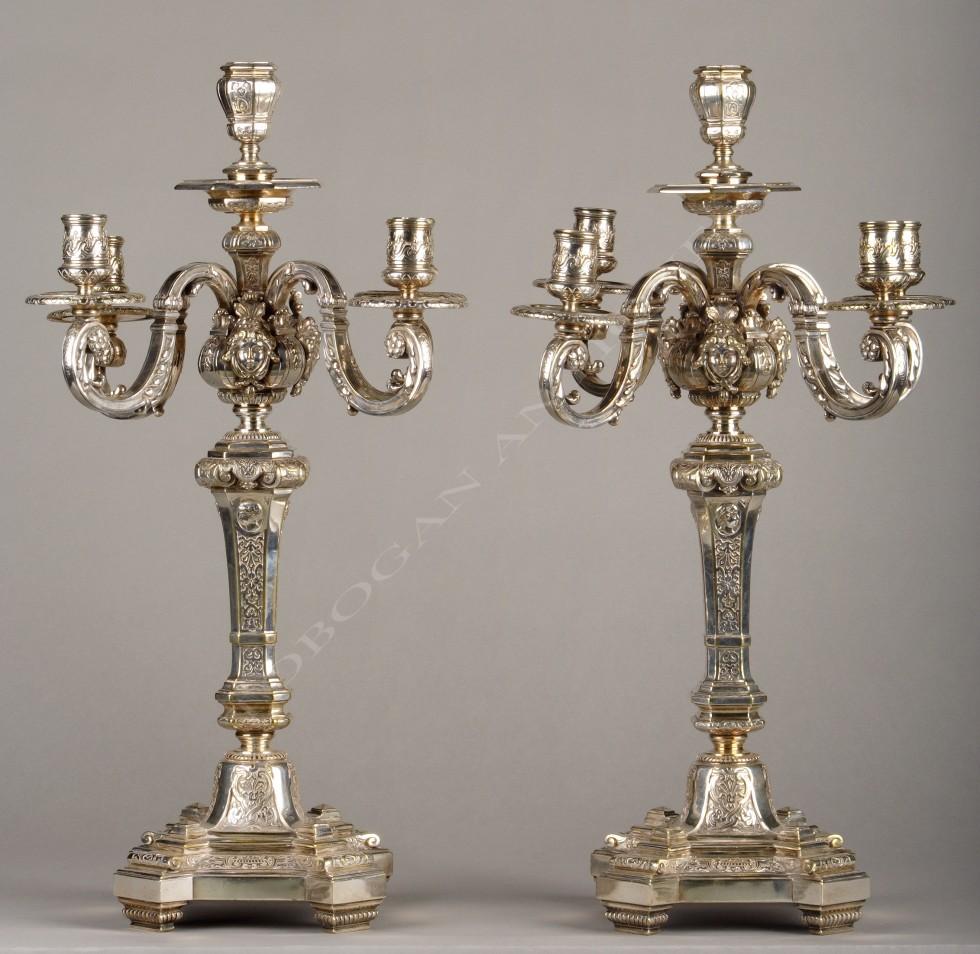 Pair of candelabras with feminine masks